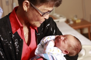 Susie McMurry holds a newborn baby in WMC's The Birth Place. Susie volunteers several hours a day with WMC patients as the founder of Gentle Hands, a patient advocacy group.