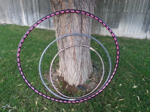 The 2 hula hoops I purchased at Target inside of my pink snazzy new hoop!  You can see the extreme difference in size - but the larger the hoop the easier it is to learn.