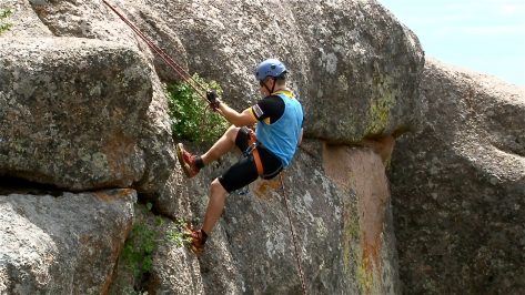 """McGinley rappels 100 feet down a boulder at Vedauwoo after trekking 5 miles in Curt Gowdy State Park and orienteering on bikes for about 12 miles to collect optional checkpoints.  """"Vedauwoo is one of the places I hadn't seen yet in Wyoming,"""" McGinley said. """"It was just really amazing."""""""