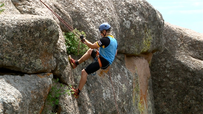 "McGinley rappels 100 feet down a boulder at Vedauwoo after trekking 5 miles in Curt Gowdy State Park and orienteering on bikes for about 12 miles to collect optional checkpoints.  ""Vedauwoo is one of the places I hadn't seen yet in Wyoming,"" McGinley said. ""It was just really amazing."""