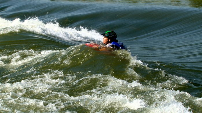 For the last leg of the race, participants belly-boarded the rapids at Casper Whitewater Park. Here, Chirdiron catches a wave. It was the first time McGinley went through Casper's rapids.