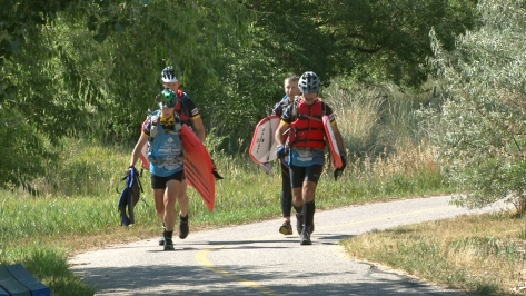 Boogie boards in tow, the team makes the last climb to the finish line at Mike Lansing Field.