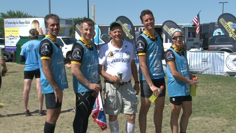 Looking decidedly less fresh than the portrait at the starting line, the team poses with a sponsor, Tom Thorson of Black Hills Bentonite.
