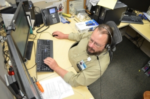Tate Belden works on system maintenance Wednesday from his desk in Information Services. He is one of 31 IS employees who keep WMC running smoothly -- technologically speaking.