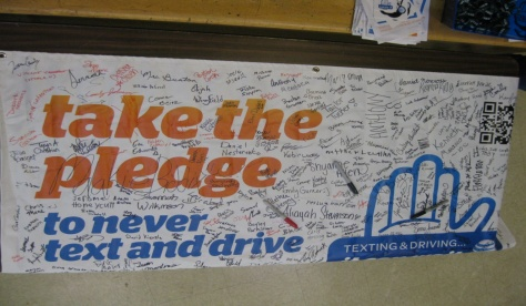 The Kelly Walsh High School pledge banner had the most signatures pledging not to text and drive.  All four schools had their own banner to sign and we left it in the offices for them to display as a reminder to the students about texting and driving.