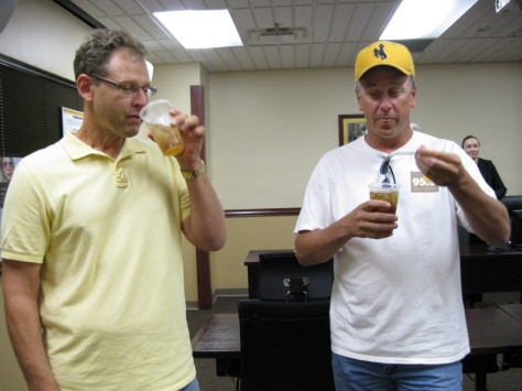 Wyoming Department of Transportation spokesman Jeff Goetz and Rick Darcy sample their drinks.
