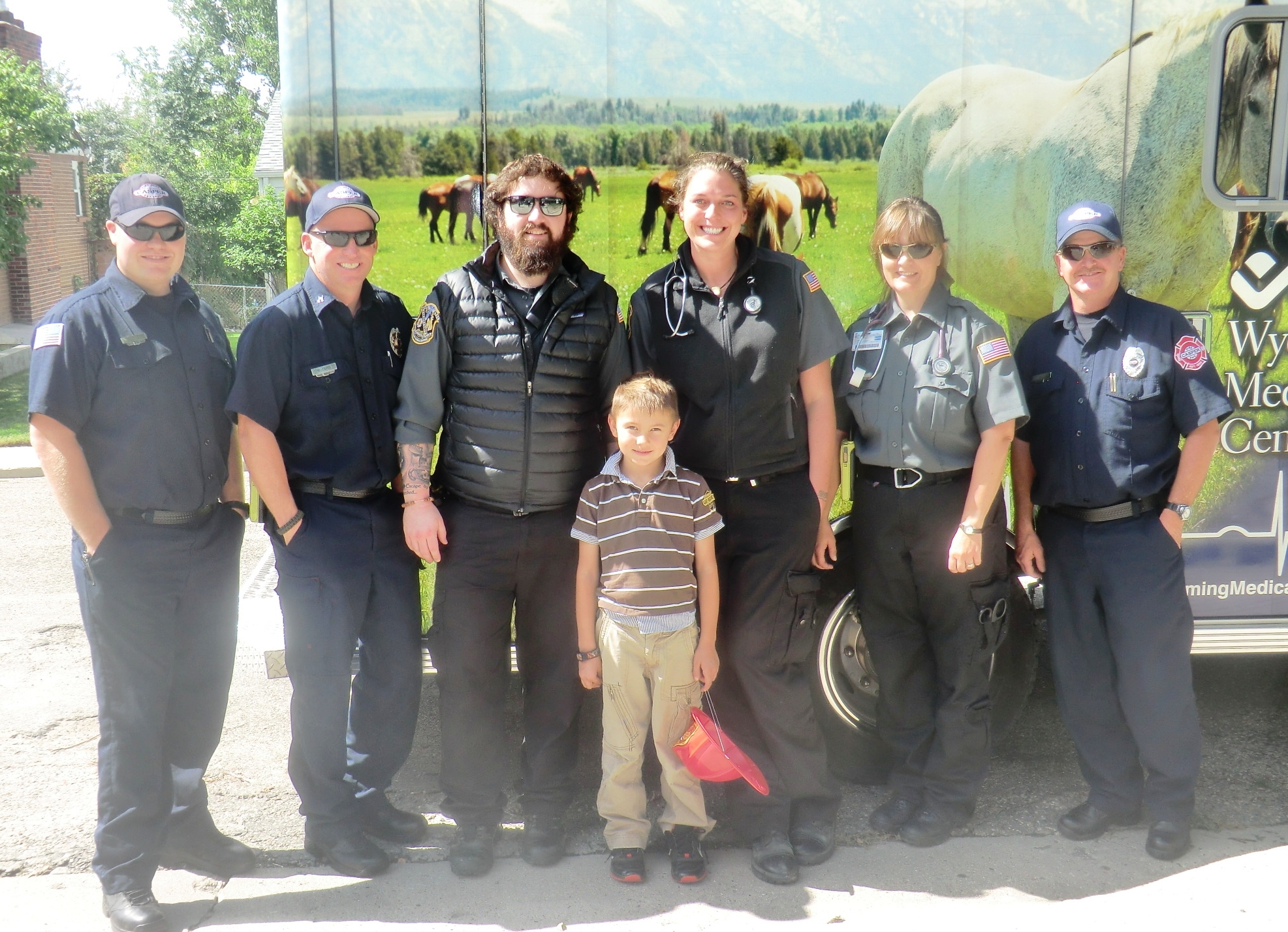 Roman LaDuke, 6, poses with the ambulance and fire crews who came to his Casper home Sept. 14. Roman has primary adrenal insufficiency and needs an immediate shot of Solu-Cortef -- a drug not carried on most ambulances around the country. His parents worked with WMC Paramedic Travis Lovelace, third from left, to get the drug approved for WMC ambulances.