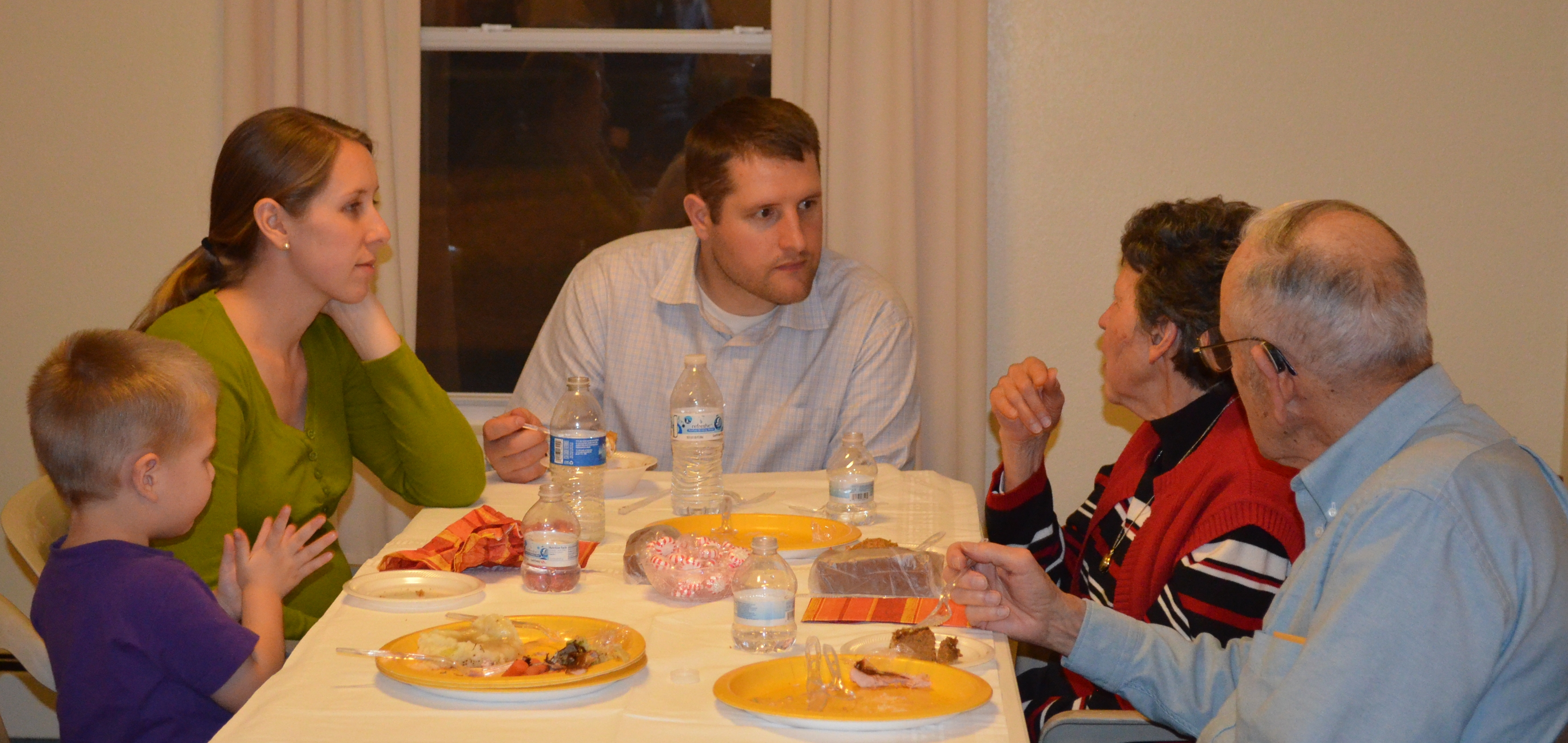 Isaac, 2, Natalie and Landon Bluemel share an early Thanksgiving meal with guests of the Masterson Place. Landon is a medical student in surgery in the University of Wyoming residency program. He and his family are staying in the Masterson Place while in Casper.
