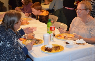 Marie Richter of Thermopolis, at right, sits with Deborah Surat of Riverton, during the Masterson Place Thanksgiving potluck on Nov. 13.