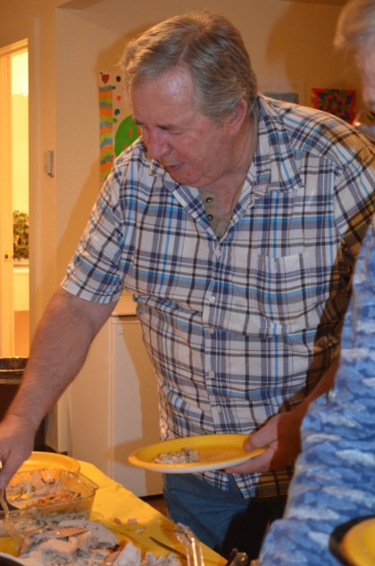 Larry Bockman fills his plate at the Masterson Place November potluck, hosted by the Wyoming Medical Center Foundation's Angels Cancer Care Program. Bockman taught himself to cook after his taste buds when haywire from chemotherapy.
