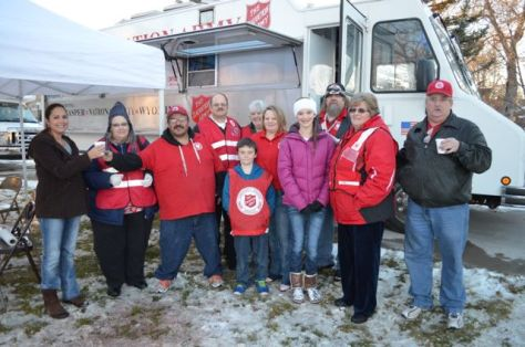 The Salvation Army volunteers (Robert King, John Potter, Tara Robbins, Asten Hejke, Debbie Mestas, Isabel Garner and Juan Paz) served hot chocolate and cookies to visitors at the 2013 Holiday Square tree lighting ceremony.