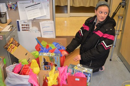 Dorian's mother, Krishelle Layton, sorts through gift bags for donation to Wyoming Medical Center on Tuesday.