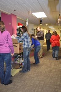 "Employees from Finance ""stuff"" the tree on Pediatrics"