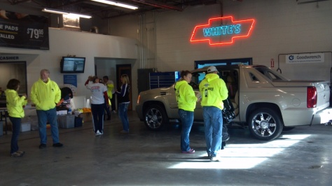 Child Passenger Safety technicians checking a car seat for a parent and child.