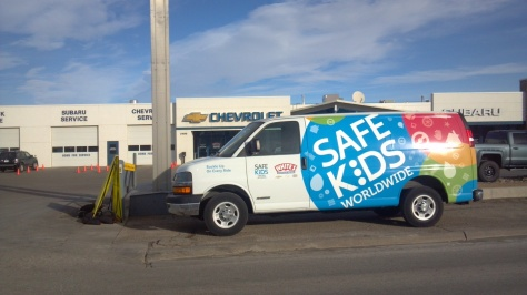 The new van graphics displayed in front of White's Mountain Motors on Sat. Jan. 11. Nice bright colors, shapes and new logos are apparent.